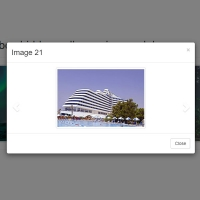 In this, we have a three-column column of photos, each of which, when clicked, displays a set of photos as a slider.